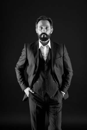 of his league. confident and charismatic ceo. just being successful. man with beard in formal wear. senior and brutal boss. well groomed male. mature businessman in suit. shadow business concept