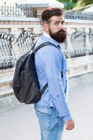 Travel to make memories. Bearded man travel in modern city. Hipster with backpack. Pleasure travel. Sightseeing around city. Summer vacation. Traveling. Wanderlust. Travel more to discover yourself