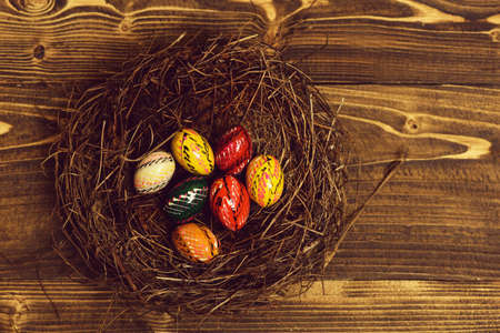 set with colorful eggs inside nest. Happy Easter concept