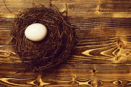 White egg inside small nest. Happy Easter concept 版權商用圖片
