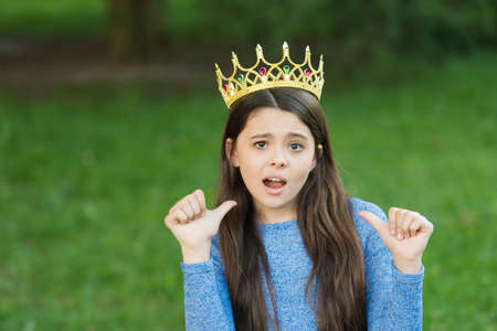 Cute girl golden crown outdoors green nature background, princess concept