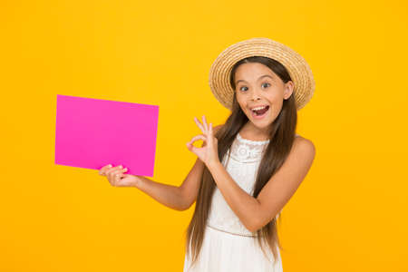 Happy girl hold poster copy space. Vacation time. Girl straw hat. Cultural event. Creative event 写真素材
