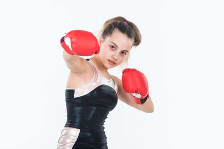 small girl training in boxing gloves. sport and fitness. teen girl boxer. sportswear and equipment shop. healthy lifestyle. energetic kids power. child workout in gym isolated on white