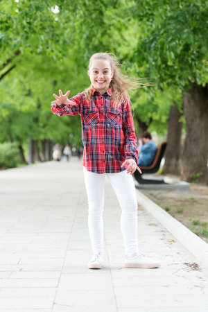 Childhood activities that will never grow old. Happy little child wearing casual plaid design for playing outdoor. Childhood activity on summer day. Happy childhood. Childhood concept