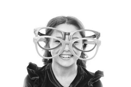 Laser correction. Eye exercises to improve eyesight. Girl kid wear big eyeglasses. Eyesight and health. Optics and eyesight treatment. Effective exercise eyes zooming. Child happy with good eyesight Stok Fotoğraf