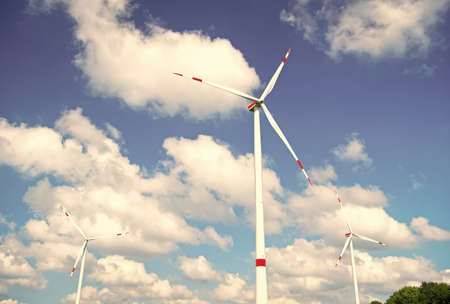Turbine or windmill blue sky background. Alternative energy source. Go green eco friendly technology. Clean fuel energy source. Advantages and challenges of wind energy. Wind turbine produce energy