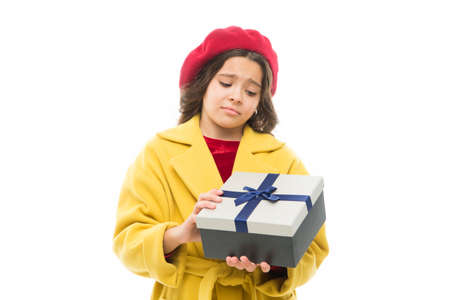 not what i expected. little girl child in french beret feel disappointment. small parisian girl with unhappy face. spring shopping. childrens day. France style. child with present box. disappointment