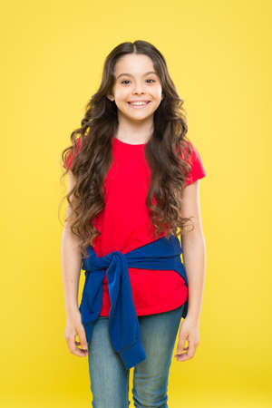 Hairdresser tip. Kid girl long healthy shiny hair. Perfect curls. Kid cute face with adorable curly hairstyle. Little girl grow long hair. Teen fashion model. Styling curly hair. Change you can see
