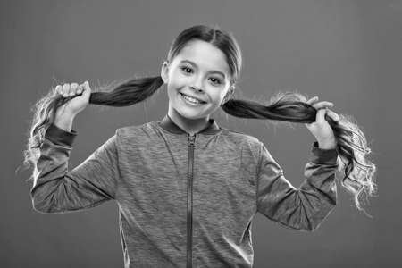 Easy tips making hairstyle for kids. Small child long hair. Charming beauty. Girl active kid with long gorgeous hair. Strong and healthy hair concept. How to treat curly hair. Nice and tidy hairstyle