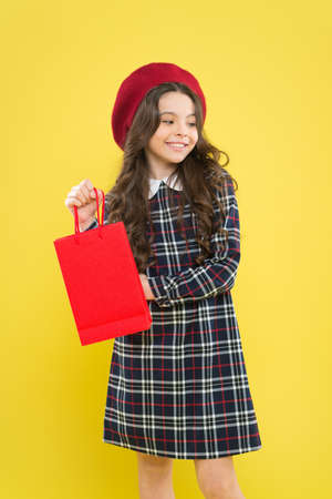 Explore fashion industry. Shopping and purchase. Black friday. Sale discount. Shopping day. Child hold package. Kids fashion. Birthday girl. Favorite brands and hottest trends. Girl with shopping bag