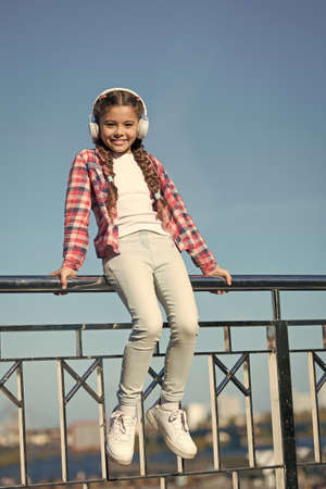 Enjoy music everywhere. Best music apps that deserve a listen. Make your kid happy with best rated kids headphones available right now. Girl child listen music outdoors with modern headphones