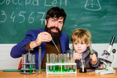 Special and unique. Genius toddler private lesson. Genius kid. Joys and challenges raising gifted child. Teacher child test tubes. Chemical experiment. Genius minds. Signs your child could be gifted