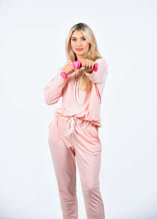 pretty woman workout with dumbbell. Sport and sportswear fashion. sport equipment shop. female fitness fashion. girl with pink barbell. fitness training with coach. exercise for hands