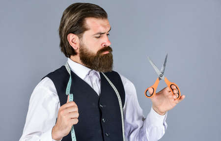 formal and office style. man tailor with tape measure and scissors. man tailoring clothes. brutal man is fashion designer. man designing for men. successful sartor ready to work. Is it good enough