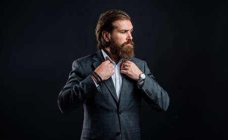 business man wear suit. official office lifestyle. serious bearded man. handsome man in expensive suit. shirt with hand watch. stylish successful man in suit posing. tuxedo fashion look
