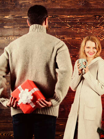 Christmas Traditions for Couples. Create unforgettable memories. Magic between them. Couple love at christmas tree. Some fun things to experience with family on Christmas Eve. Feeling cozy together Stok Fotoğraf