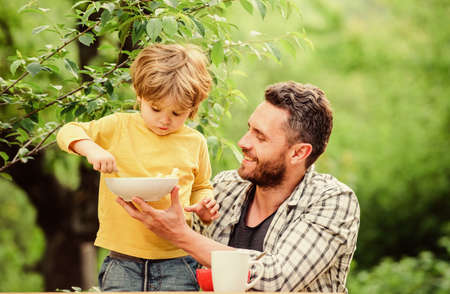 Menu for children. Family enjoy homemade meal. Father son eat food and have fun. Nutrition habits. Little boy and dad eating. Nutrition for kids and adults. Healthy nutrition concept. Feeding baby