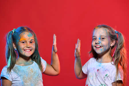 Schoolgirls have paint spots on faces. Girls with smiling face
