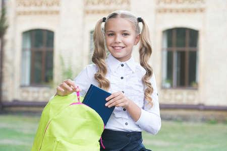 Girl primary school pupil happy going to school, doing homework concept