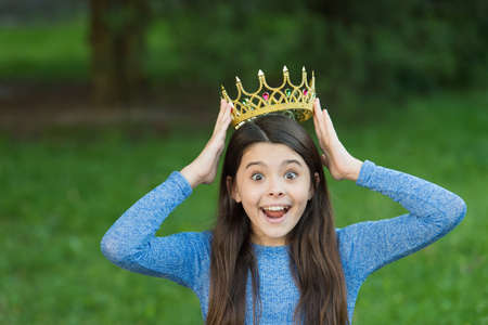 Cute girl golden crown outdoors green nature background, such an honor concept