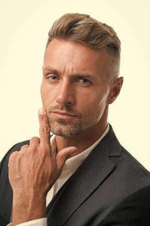 Portrait of mature macho. Gentleman hipster hairstyle. Barber shop concept. Beard and mustache. Guy well groomed handsome macho tuxedo. Hipster groom. Serious glance. Attractive mature hipster Foto de archivo