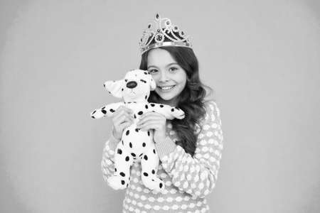 I am so happy. She deserves best. Girl play with dog toy. Winner of beauty competition. girl in crown holding birthday present. Shop for best luxury gifts. Spoiled child concept. real pet lover