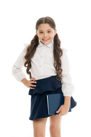School textbook and stationery concept. Child school uniform smart kid happy hold textbook. Girl happy face carry textbook white background. Child girl school uniform clothes hold book ready to study