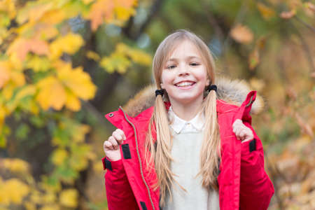 Happy little girl wear autumn fashion. Happy little girl smile outdoor. Be in fashion. Must have fashion for fall. Autumn is a second spring when every leaf is a flower