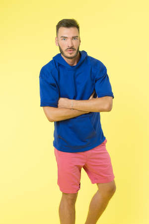 Clothing for active lifestyle. Choose comfortable clothes made out of soft textile to stay active. Comfortable outfit for active leisure. Man athletic appearance wear stylish clothes for youth