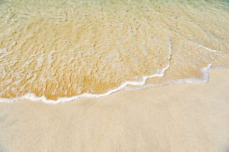 wavy sea, ocean water background on sand coast in Antigua