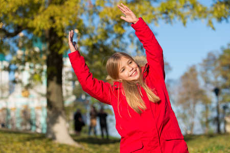 Full of life energy. Keep body warm clothes autumn days. Autumn outfit concept. Kid girl wear coat for autumn season nature background. Child cheerful on fall walk. Warm coat best choice for autumn
