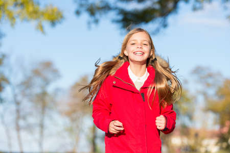 Full of life energy. Child cheerful on fall walk. Warm coat best choice for autumn. Autumn outfit concept. Kid girl wear coat for autumn season nature background. Keep body warm clothes autumn days