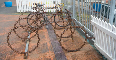 Bicycle parking as art object. Cycling culture and infrastructure. Bicycle parking made out of brutal metal chain. Leave your bike here. Bicycle transportation system. Urban cycling infrastructure