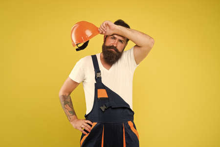 Engineer builder uniform. Man builder hard hat. Creativity and practice. Major renovation places strong emphasis natural materials and sustainability. Improvement and renovation. Brutal man builder