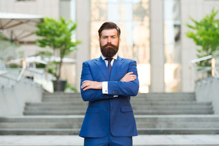 charmed life. Confident and handsome. serious bride groom crossed hands outdoor. brutal male beauty. formal and office fashion. man in suit wait at stairs. leadership concept. Businessman wear jacket