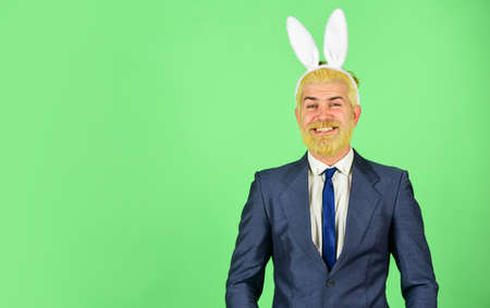 Happy Easter. Happy businessman wear rabbit ears. Bearded man celebrate Easter. Easter celebration. Spring holidays. Easter bunny is here, copy space