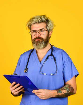 Man bearded doctor with folder Reklamní fotografie