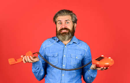 Bearded man phone conversation.