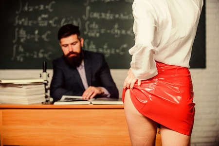 All this erotica doesnt get him at all. Red skirt erotica. Sexy female hips and buttocks. Selective focus. School erotica. Erotica and romance