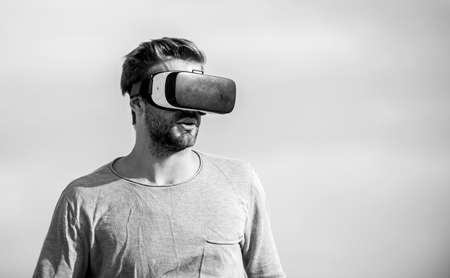 It is so real. male reality. looking modern. create own business. Digital future and innovation. macho man wear wireless VR glasses.. guy virtual reality goggles. sexy man sky background vr glasses