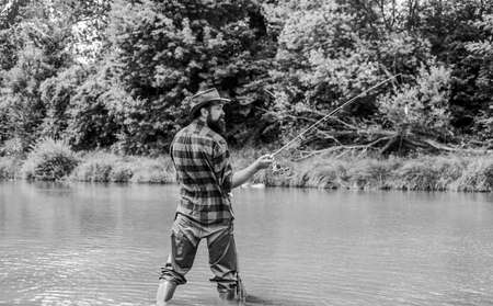 Fishing is the Reel Deal. summer weekend. Big game fishing. mature man fly fishing. man catching fish. bearded fisher in water. fisherman with fishing rod. hobby and sport activity. pothunter