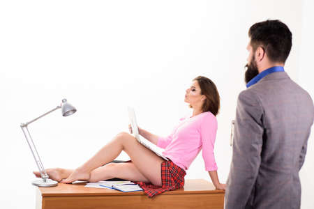 Sexy personal secretary. Full of desire. Sexy lady worker attractive legs sit on table. Boss excited about sexy secretary. Career growth. Triggers of sexual desire. Office manager or secretary