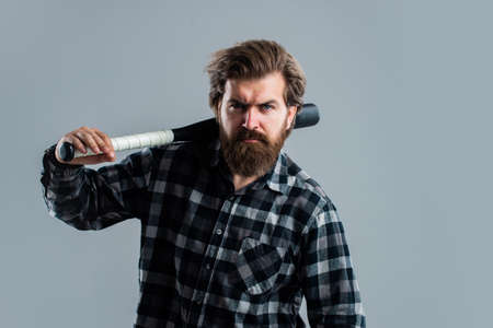relax after training. outdoor sport activity. man with baseball bat. i am a criminal. aggression and anger. brutal male hipster ready to fight. mature man in checkered shirt. success at any cost