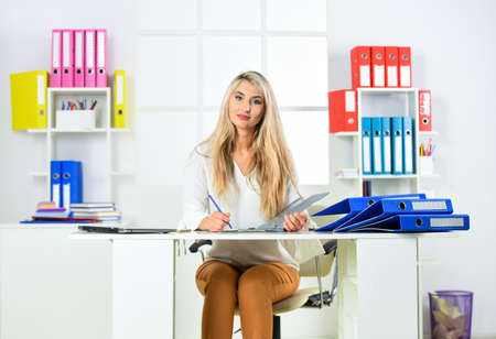 Business woman work in office with documents. Female career. Organized office work. Routine paperwork. Manager or coordinator. Female leadership. Female business. Accounting paper documents files