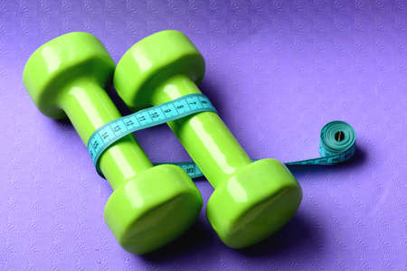 Barbells in small size next to cyan ruler