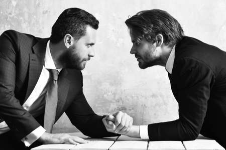 Lawyers arm wrestling. Leadership and competition concept