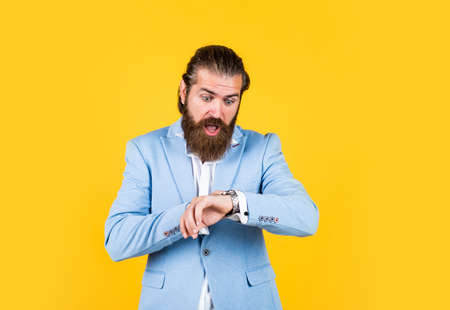 oh no. man having late. male business fashion. hipster wear blue jacket. barbershop concept. Intelligent Businessman with beard. Bearded Man In classical style. glamour bride groom
