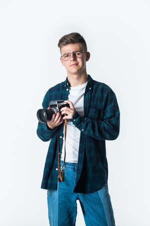 Ready to work. young talented photographer. faculty of journalism student. vintage camera technology. shooting with professional camera. photographing is his hobby. teen guy with retro photo camera Stock fotó