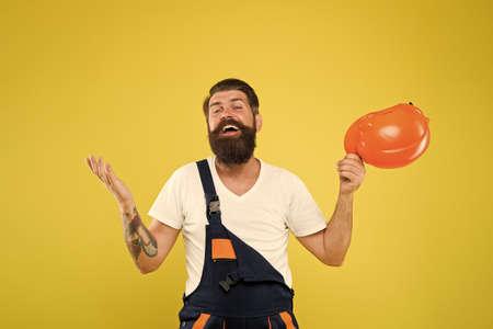 Feel relief. Finally. Engineered environment trend. Builder hard hat. Improvement and renovation. Brutal man builder. Bearded guy worker on yellow background. Engineer builder uniform. Home decor Standard-Bild