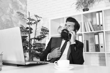 Mobile phone communication. Bearded man talk on phone in office. Businessman establish communication with customers. Business communication. Communication system. 3G. 4G. New technology